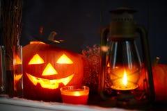 Halloween symbols. Halloween pumpkin, lantern and burning candle stock photos