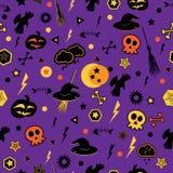 Halloween symbols on violet background. Royalty Free Stock Images