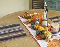 Halloween table decor. Halloween kitchen table decor showing witch, pumpkins, gourds Stock Photos