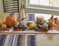 Halloween table decor. Halloween kitchen table decor showing witch, pumpkins, gourds Stock Photo