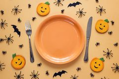 Halloween table setting with cutlery, decorative pumpkins, spide Royalty Free Stock Photo