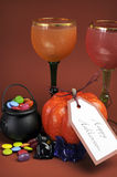 Halloween table setting decorations with goblets - vertical. Royalty Free Stock Image