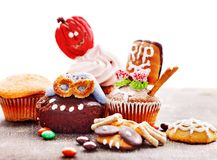 Halloween table with trick or treat. And cake. Isolated Stock Images