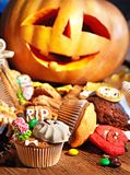 Halloween table with trick or treat. Carving pumkin Royalty Free Stock Photo