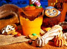 Halloween table with trick or treat. And drink Royalty Free Stock Images