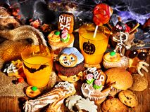 Halloween table with trick or treat. And cake Royalty Free Stock Photo