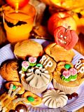 Halloween table with trick or treat. And cake Stock Photography