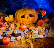 Halloween table with trick or treat Royalty Free Stock Photography