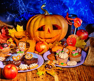 Halloween table with trick or treat Stock Image