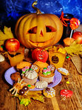 Halloween table with trick or treat Jack OLanten pumpkin. Stock Photos