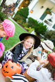 Halloween: Taking A Break To Look At Candy Royalty Free Stock Image
