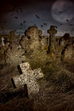 Halloween terrible Cemetery with old gravestones crosses, the mo Royalty Free Stock Image