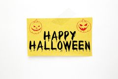 Halloween text on brown paper Stock Image