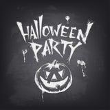 Halloween text design with pumpkin on chalkboard Stock Image