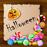 Halloween text frame with candies and pumpkin stic Stock Photo