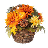 Halloween or Thanksgiving Bouquet with pumpkin and Autumn flowers in basket, isolated