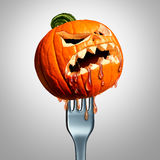 Halloween Thanksgiving Food Symbol. As a pumpkin jack o lantern with a fork through it as an autumn seasonal meal or harvest time snack concept with 3D Stock Photo