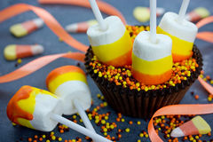 Halloween or Thanksgiving recipe candy corn marshmallow pops Stock Photo