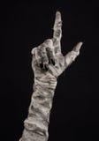 Halloween-thema: vreselijke oude brijhanden op een zwarte achtergrond Stock Afbeelding