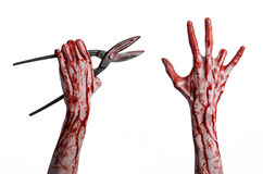 Halloween theme: bloody hand holding a big old bloody scissors on a white background Royalty Free Stock Photo