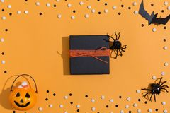 Halloween theme with gift box. On a orange background stock photos