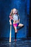 Halloween theme: Girl with baseball bat ready to hit. On dark background Royalty Free Stock Image