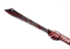 Halloween theme: hand holding a bloody machete on a white background Royalty Free Stock Photography
