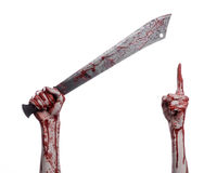Halloween theme: hand holding a bloody machete on a white background Royalty Free Stock Photo