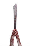 Halloween theme: hand holding a bloody machete on a white background Stock Photo