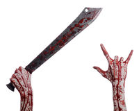 Halloween theme: hand holding a bloody machete on a white background Royalty Free Stock Image