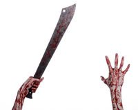 Halloween theme: hand holding a bloody machete on a white background Stock Photography