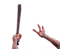 Halloween theme: hand holding a bloody machete on a white background Royalty Free Stock Photos