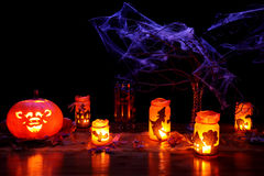 Halloween theme photo - landscape. Halloween theme photo with jack-o-lantern, spider web and candle lights Stock Photo
