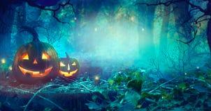 Halloween theme with pumpkins and dark forest. Halloween design stock photo
