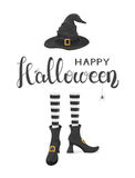 Halloween theme with witches legs in shoes and hat Stock Photo