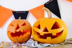 Halloween themed image with carved pumpkins in house party environment. stock photography