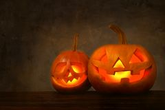 Halloween themed image with carved pumpkins in house party environment. royalty free stock image