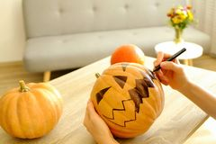 Halloween themed image with carved pumpkins in house party environment. royalty free stock photography