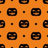 Halloween tile vector pattern with black pumpkin and polka dots on orange background Stock Photography