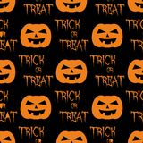 Halloween tile vector pattern with orange pumpkin and trick or treat on black background Royalty Free Stock Photo