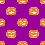 Halloween tile vector pattern with orange pumpkin on violet background Royalty Free Stock Photography