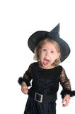 Halloween time. Adorable little girl dressed in witch costume Stock Image
