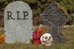Halloween Tomb Stones. A Halloween grave stones decoration with a skull Stock Image