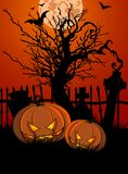 Halloween Tombstone and Pumpkins Stock Photo