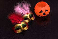 Halloween toys for kids, masks and pumkin light. Isolated on black background royalty free stock image