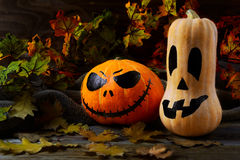 Halloween traditional jack-o-lantern and fall leaves stock photos