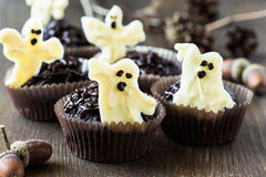 Halloween treats, chocolate muffins with  sweet white chocolate Royalty Free Stock Images
