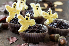 Halloween treats, chocolate muffins with  sweet white chocolate Royalty Free Stock Photography