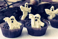 Halloween treats, chocolate muffins with  sweet white chocolate Stock Photography