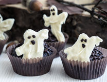 Halloween treats, chocolate muffins with  sweet white chocolate Royalty Free Stock Photos
